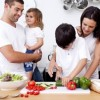 children_cooking_vegetables_with_parents-300x257