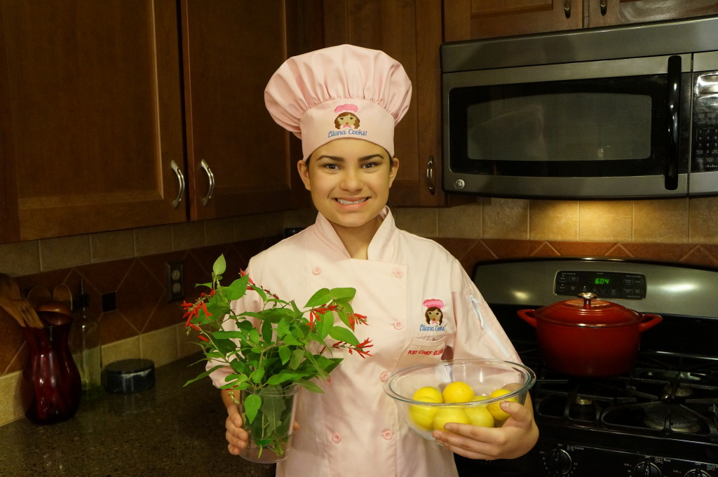 Kid Chef Eliana with garden pineapple sage and Meyer lemons Nov 2014